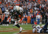 {seqn} Denver Broncos Eddie Royal scores a two-point conversion late in the fourth quarter against...