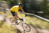 Paul Conrad The Aspen Times  Seven time Tour de France champion Lance Armstrong rounds a corner in...