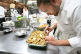 Steve Youngman, a student from Culinary School of the Rockies, makes apple crisp at the school...