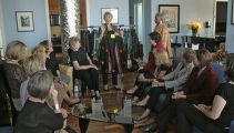 Susan Kiely (cq), center, shows outfits to some friends, some will also be models in the Runway to...