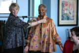 Susan Kiely (cq), left, tries one of the outfits that will be part of Runway to India fashion...