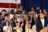 The crowd cheers and waves their hats and hands in the air as U.S. Senator Barack Obama speaks at...