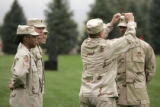 (Colorado Springs, Colo., October 5, 2004) Lt. Col. Tim McKernan, center, fixes the hat of Lt....