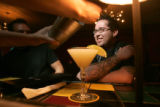 0092 Roman Padilla enjoys happy hour at at Dazzle, 930 Lincoln St., a four dollar drink during...