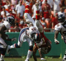 JOE0824 Denver Broncos Champ Bailey (24) upends Kansas City Chiefs Larry Johnson causing a fumble...