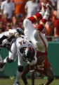 JOE0825Denver Broncos Champ Bailey (24) upends Kansas City Chiefs Larry Johnson causing a fumble...