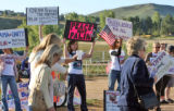 Palin protestors asemble with signs Monday morning September 15,2008  where Republican...