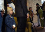 (10/06/2004) Englewood-Spencer Daly, 4, waits with her parents Rachel and Gordon to meet Teresa...