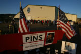 Hundreds of Palin supporters, volunteers and McCain/Palin campaign personnel line up outside of...