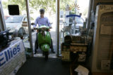 Eco-Products Founder and President Steve Savage, backs an electric scooter out of the company's...