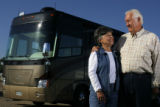 DM0253  Ken and Judy White pose for a portrait with their recreational vehicle near their home in...