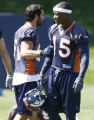JOE0581 Denver Broncos Nate Jackson, left, greets Brandon Marshall practice at their headquarters...