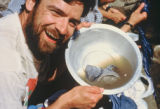 Jim Davidson laughs as he cleans his socks while on an expedition in Nepal in 1998 in Namch...
