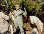 Jim Davidson, center, after painting an electrical tower during the summer of 1982. Jim was...