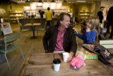Peter Bryant (cq) talks with his daughter Elyse, 7, (cq) inside Origins store at 2800 E. 2nd...