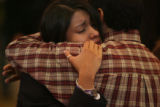 Locked in a tearful embrace, New Life Church member, Edith Quezada (cq) hugs her father, Jose...