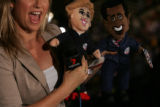 Rahni Sadler, a reporter for 7 Network in Australia, displays a Hillary Clinton and Barack Obama...