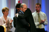 Republican candidate for Governor Bob Beauprez hugs campaign manager, John Marshall while standing...