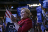 Pat Waak, chair for the Colorado Democratic Party, applauds at the Pepsi Center during the...