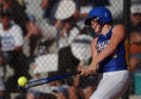 MARC PISCOTTY/NEWS STAFF PHOTOGRAPHER SHOT 10/17/2003 - Wheat Ridge's #7-Tara Mickelson hits...