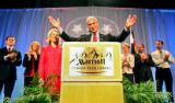 Bob Beauprez acknowledges the crowd's applause while preparing to give his concession speech while...