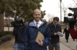 Cherry Creek School District Teacher Jay Bennish makes his way out from the school districts...