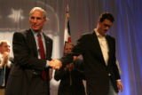 Republican candidate for Governor, Bob Beauprez shakes the hand of his campaign manager John...