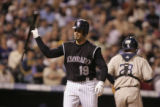The Colorado Rockies' Ryan Spilborghs dumps his bat in frustration as he strikes out to end the...