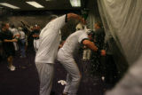 The Colorado Rockies celebrate in their clubhouse after their 9-8 victory in 13 innings. The...