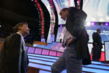 Mark Warner, right, talks with Larry Sabato (cq), the director of the Center for Politics at the...