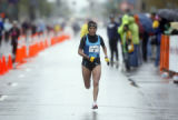 ///Elite full marathon runner Martha Tenorio (cq) runs the final stretch. Tenorio took the first...