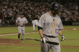 Colorado Rockies Todd Helton after striking out in the tenth inning at Chase Field during Game 2...