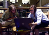 [Denver, CO - Shot on: 9/20/04] Sara Yelton (left) , a third year law student and TA, helps...