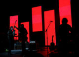 R.E.M. performs at Red Rocks Amphitheatre. Modest Mouse and The National are opening bands.  Red...