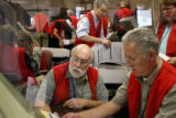 Election judges count ballots at the Denver Election Division on the morning of the 2008 general...
