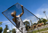 (DENVER, Colo., Aug. 25, 2004)  Marlene Sena, cleans a window at her mothers South Lincoln Park...