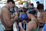 (Arvada, Colo.,  Sept. 20, 2004) Olympic swimmer Lenny Krayzelburg, left, signs a medal for Kiana...