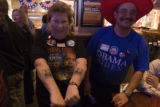 (253) Dottie Rawsky, 62, of Broomfield, shows off her Obama tattoos at an event organized by the...