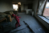 Rudolph Montes, 4, tip toes across broken glass in his home in Windsor. He and his mother and...