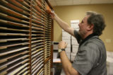 Jerry Hoover, temp worker, sorts 400 ballots by style in special cabinets at the Denver Election...