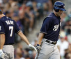 DXF104 - Milwaukee Brewers' J.J. Hardy, left, congratulates teammate Russell Branyan as he crosses...