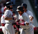 ANS103 - Boston Red Sox Manny Ramirez, center, gets congratulated by Johnny Damon, left, and Gabe...