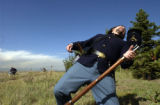 (LAKEWOOD, Colo., October 5, 2004) Paul Peubla, of Lakewood, Colo., enacts taking a hit and...