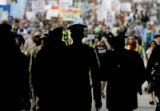 Anti Iraq war protesters and others march through downtown Denver near the site of the Democratic...