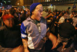 A large crowd shut down the street at the corner of 15th st. and Court Place in downtown Denver,...