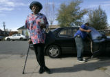 Della Matthews (cq), 83, waits for Obama volunteer Darrell Nulan to lock his car and help her into...