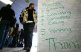 A sign at a call center for Democratic Presidential candidate John Edwards on the day of the Iowa...