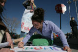 Kalen Acquisto, 17, (cq) creates a sign with Lucy Westerfield, 15, (cq) (Left) and Alyssa Roberts,...