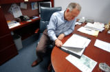 John Ramsey signs campaign letters in his office located in the office of Patsy Ramsey's Northwest...