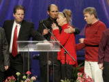 Director of Denver YWAM Peter Warren hugs Diane Jacobson, the mother of Tiffany Johnson, who was...